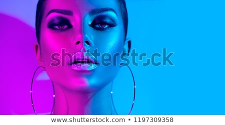 Beautiful girl with bright vivid purple make-up  stock photo © svetography