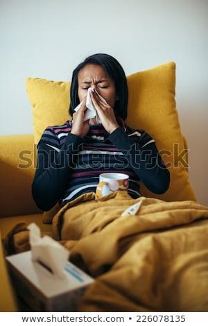 Fiatal beteg nő orrot fúj papír szalvéta Stock fotó © RAStudio