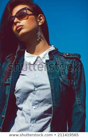 grunge styled portrait of gorgoeus young brunette in sunglasses stock photo © lithian