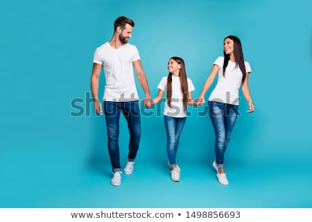 пару ходьбе улице , держась за руки счастливым Сток-фото © tekso