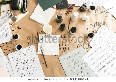 Foto stock: Paper Ink And Calligraphy Pens Lettering Workshop Details