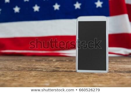 Bandeira americana telefone móvel mesa de madeira fundo tabela Foto stock © wavebreak_media