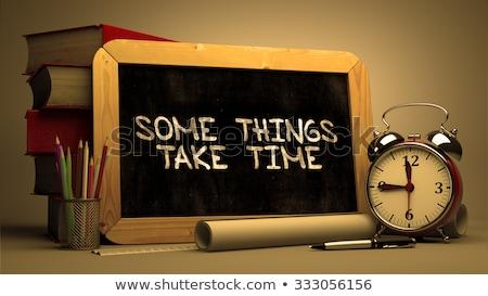 some things take time handwritten by white chalk on a blackboard stock photo © tashatuvango