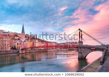 View of footbridge on Saone river at sunset Stock photo © vwalakte