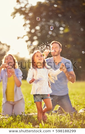 man in sun with bubbles stock photo © is2