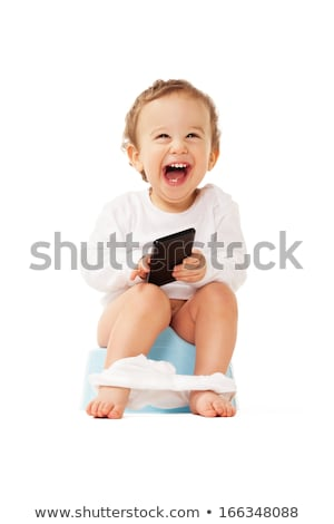 smiling baby with a phone on the potty Stock photo © Traimak