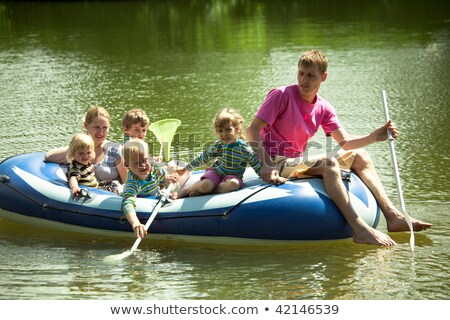 Stock photo: Girl and boy swimming with rubber boat