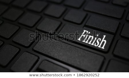 Press Button Finish on Black Keyboard. Stock photo © tashatuvango