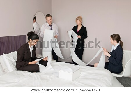 A business foursome read computer paper Stock photo © IS2