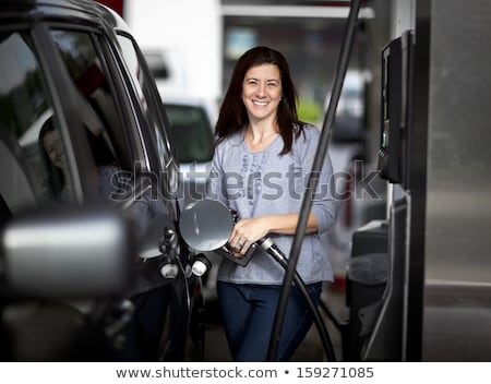 Kobieta benzyny samochodu stacji benzynowej działalności Zdjęcia stock © vlad_star