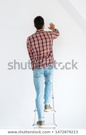 man standing on ladder stock photo © andreypopov