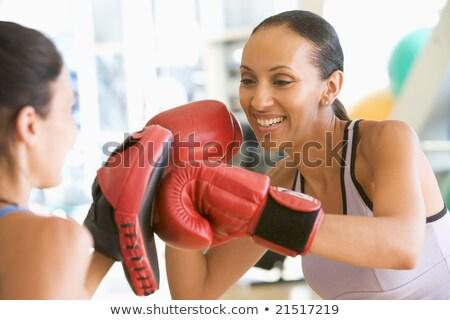 Trainer assisting a female boxer Stock photo © wavebreak_media