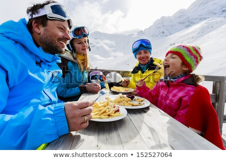 Mother and daughters skiing Stock photo © IS2