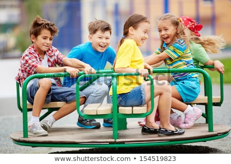 little girl on merry go round stock photo © is2