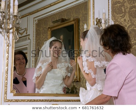 Mother and bride looking at reflection Stock photo © IS2