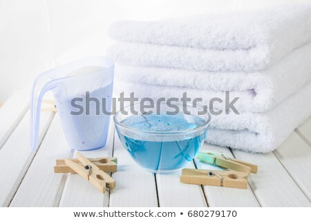 Stok fotoğraf: Bath Towels And Washing Powder In Measuring Cup