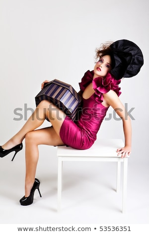 full length portrait of fashion woman 20s wearing dress holding stock photo © deandrobot