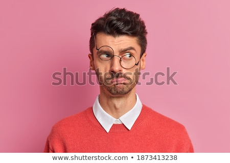 European guy with stubble in white shirt looking aside, isolated Stock photo © deandrobot