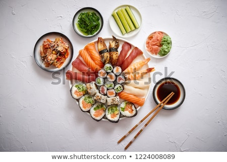 various sushi rolls placed on round ceramic plate stock photo © dash