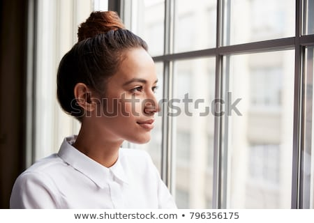 Businesswoman with hair bun Stock photo © Traimak