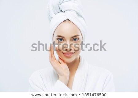 Aranyos mosolygó nő jelentkezik arckrém visel fehér Stock fotó © dashapetrenko