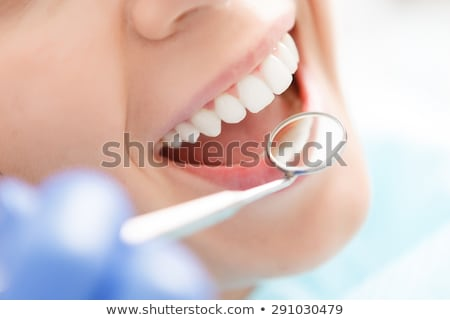 dentist with patient having toothache at clinic Stock photo © dolgachov