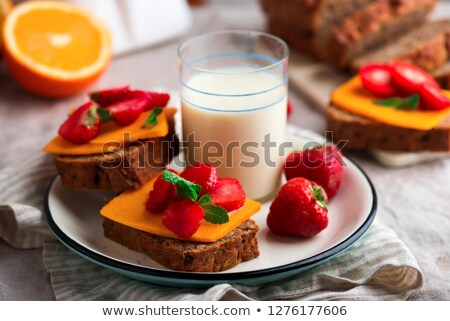 Cheese and strawberry sandwiches and soy milk.Healthy breakfast. Stock photo © zoryanchik