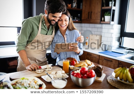 couple cooking food at home kitchen stock photo © dolgachov
