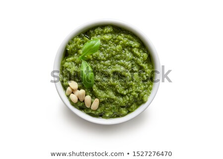 Homemade pesto sauce in glass jar. Top view. Stock photo © Illia