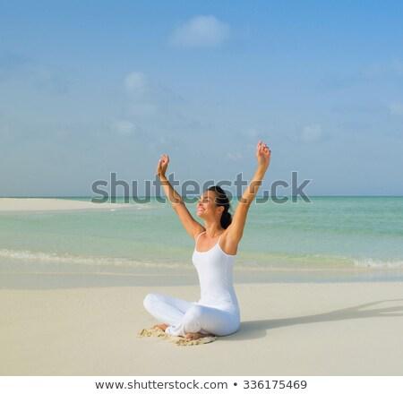 Healthy latino woman doing yoga Stock photo © doodko