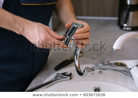 Plumber Fixing Faucet In Kitchen Stock photo © AndreyPopov