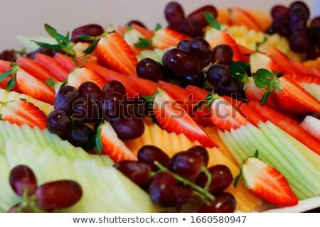 fruit platter with watermelon mango pineapple lime melon and stock photo © dashapetrenko