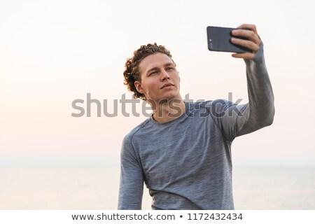 telefon · deniz · tam · uzunlukta · görüntü · bakıyor - stok fotoğraf © deandrobot