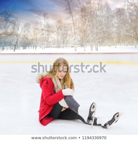 young woman fell down on outdoor skating rink Stock photo © dolgachov