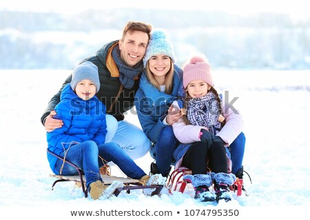 Mother and Father, Kids Sitting on Sledges Winter Stock photo © robuart