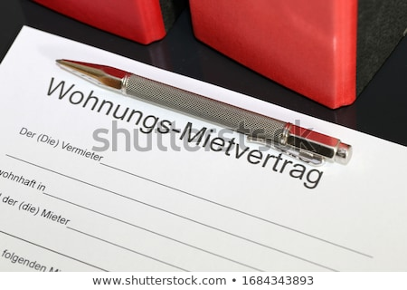 A Rental agreement with a pen on a desk - Mietvertrag (German) Stock photo © Zerbor