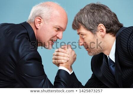 Due determinato imprenditori testa sfidare Foto d'archivio © Giulio_Fornasar