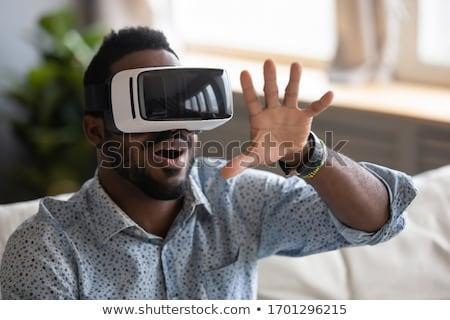 любопытный человека играет видеоигра темные очки серьезный Сток-фото © pressmaster