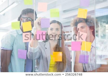 toevallig · zakenman · naar · sticky · notes · kantoor · venster - stockfoto © andreypopov