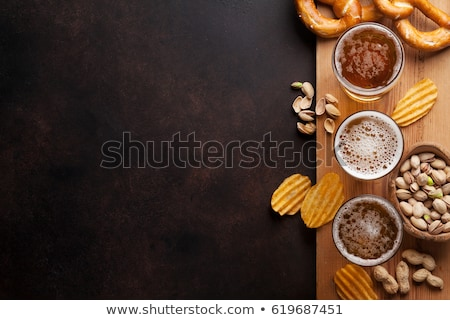 beer snacks pistachio nuts stock photo © karandaev