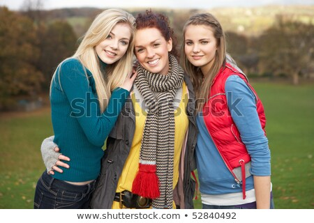 group of three teenage female friends in autumn landscape stock photo © monkey_business