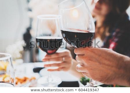 Boldog pár iszik vörösbor étterem ünneplés Stock fotó © dolgachov