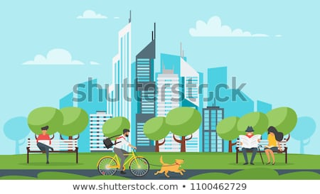 Man Sits On Bench In City Park With Modern Laptop Foto d'archivio © curiosity