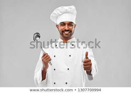 happy male indian chef in toque with ladle Stock photo © dolgachov