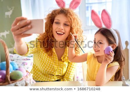 happy smiling young woman making easter bunny ears stock photo © dolgachov