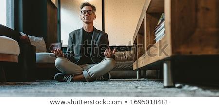 Сток-фото: бизнесмен · йога · молодые · за · столе · служба