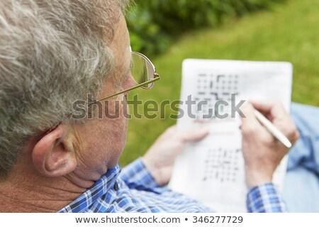 Idős férfi keresztrejtvény puzzle kert agy Stock fotó © HighwayStarz