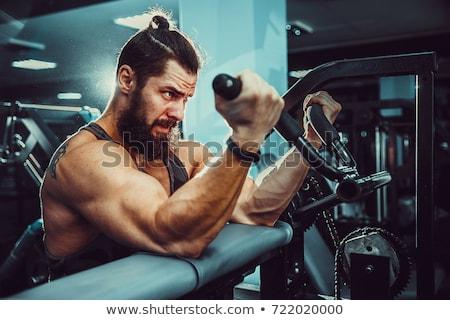 Bodybuilder biceps gymnasium jonge oefening Stockfoto © Jasminko