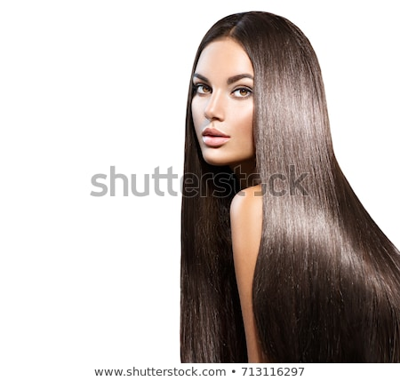 Young woman with straight hair on dark background Stock photo © Lopolo