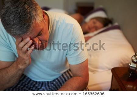 Adam yatak uykusuzluk kitap mutlu Stok fotoğraf © Elnur